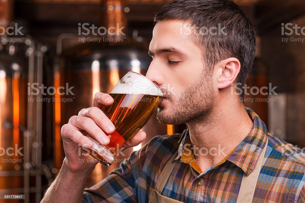 Tasting fresh brewed beer. stock photo