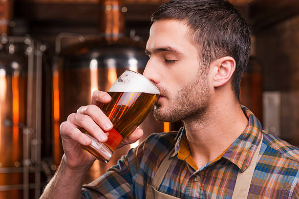 Tasting fresh brewed beer. stock photo