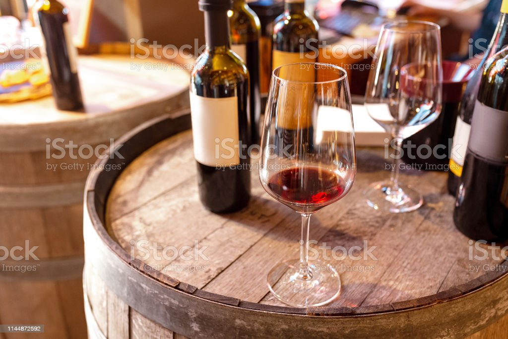 Tasting red wine in winery shop Tasting red wine in winery shop Alcohol - Drink Stock Photo