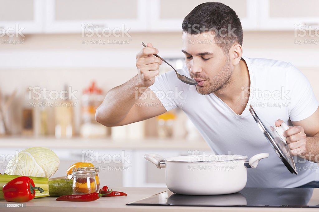 Tasting soup. stock photo