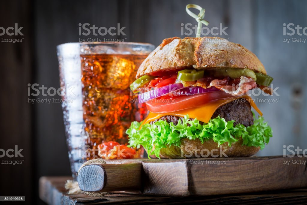 Tasty and homemade burger with cold drink with ice stock photo