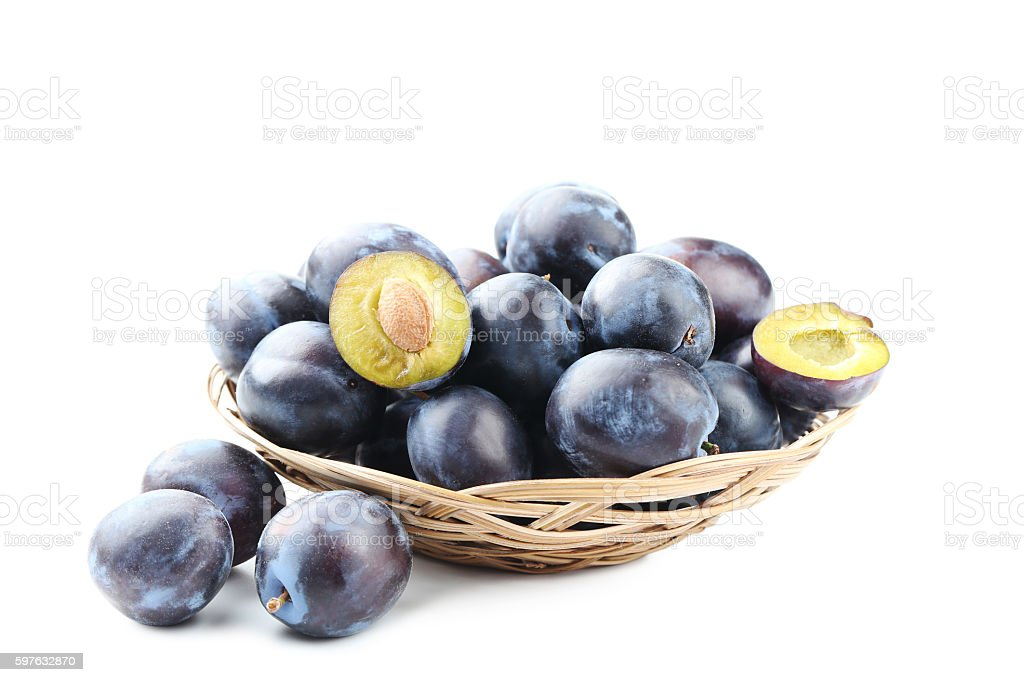 Tasty and ripe plums isolated on a white stock photo