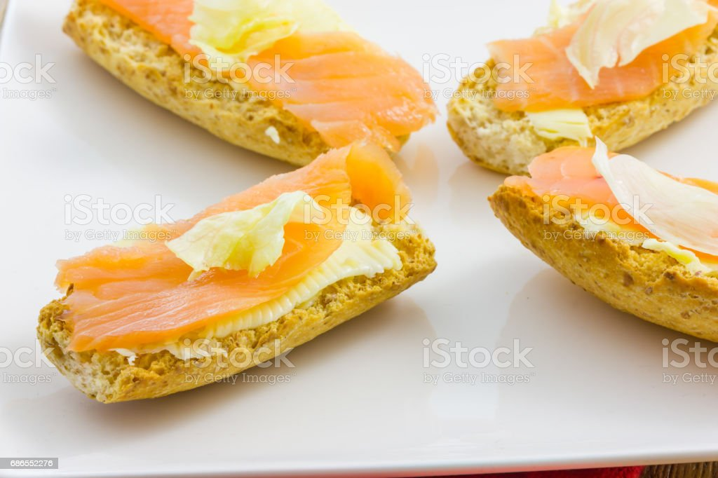 Tasty appetizer of salmon canapes royalty-free stock photo