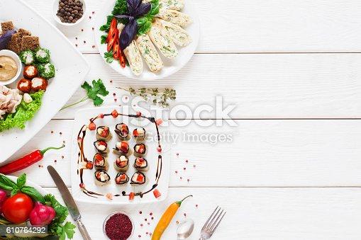 istock Tasty appetizing snacks, flat lay, free space 610764292