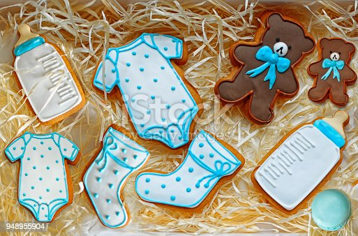 istock Tasty baby newborn cookies decorated with glaze in box 948955904