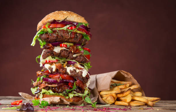 tasty big burger on wooden table - large stock pictures, royalty-free photos & images
