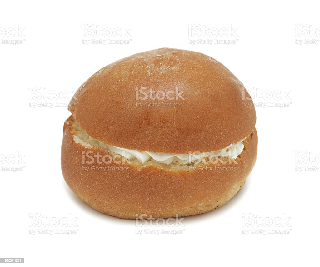 Tasty bread roll with cream, isolated royalty-free stock photo