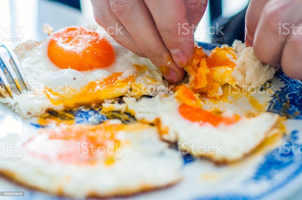 tasty breakfast. a man eating his breakfast eggs stock photo