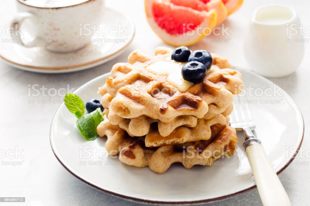 Tasty breakfast with belgian waffles, fruits, coffee stock photo