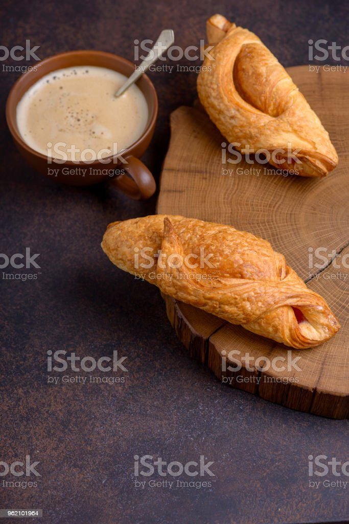 Tasty breakfast with croissant and coffee cup stock photo