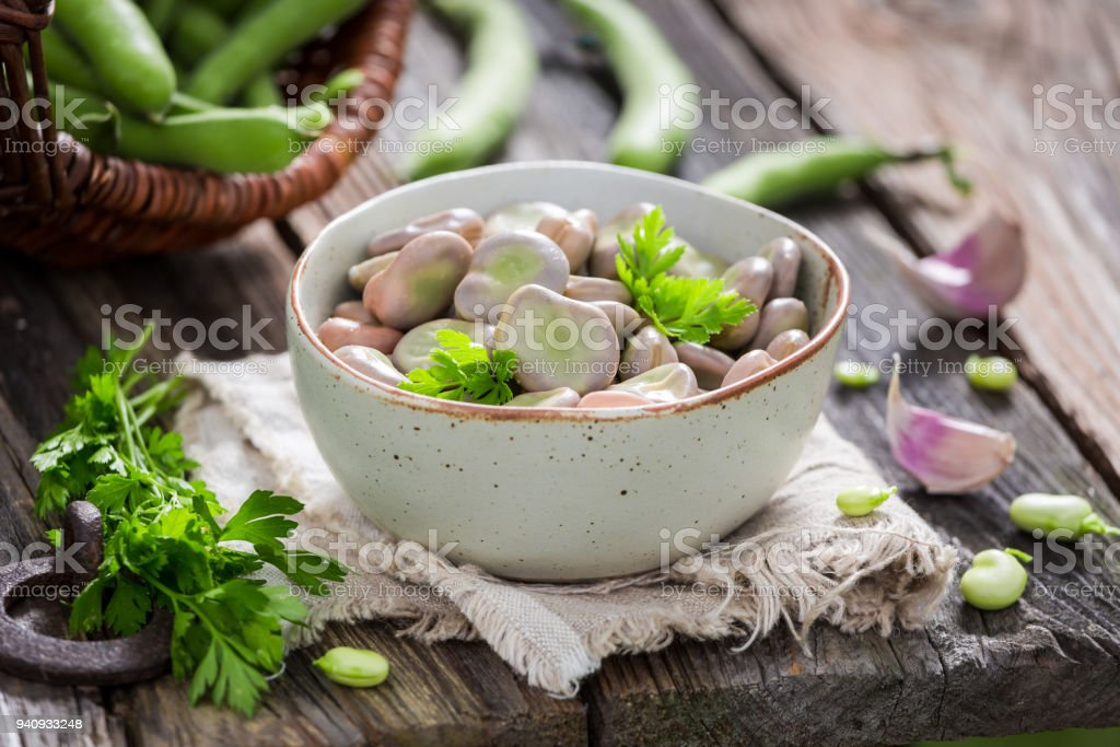 Tasty broad beans in old rustic kitchen stock photo