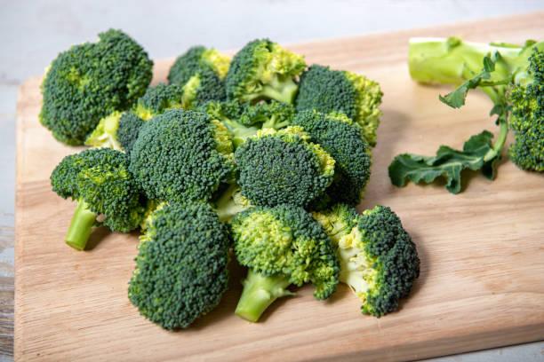 tasty broccoli on a wooden board stock photo
