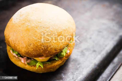 istock Tasty burger with fresh buns, meat and salad 1134596146