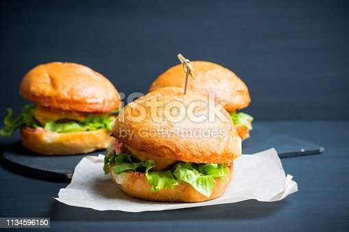istock Tasty burger with fresh buns, meat and salad 1134596150