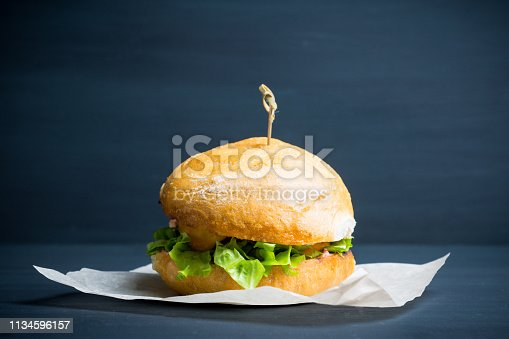istock Tasty burger with fresh buns, meat and salad 1134596157