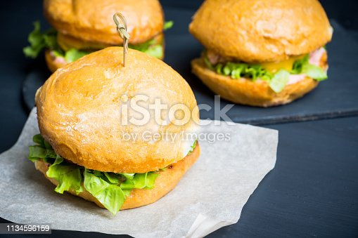 istock Tasty burger with fresh buns, meat and salad 1134596159