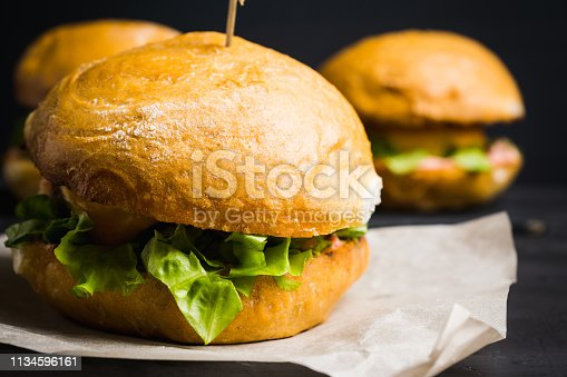istock Tasty burger with fresh buns, meat and salad 1134596161