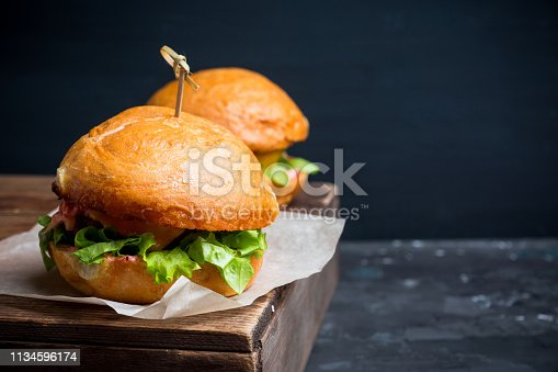 istock Tasty burger with fresh buns, meat and salad 1134596174
