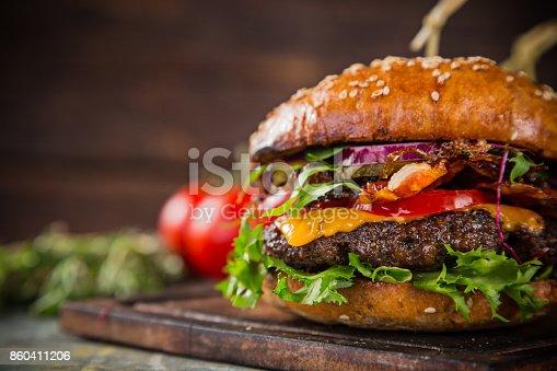 860251286istockphoto Tasty burgers on wooden table 860411206