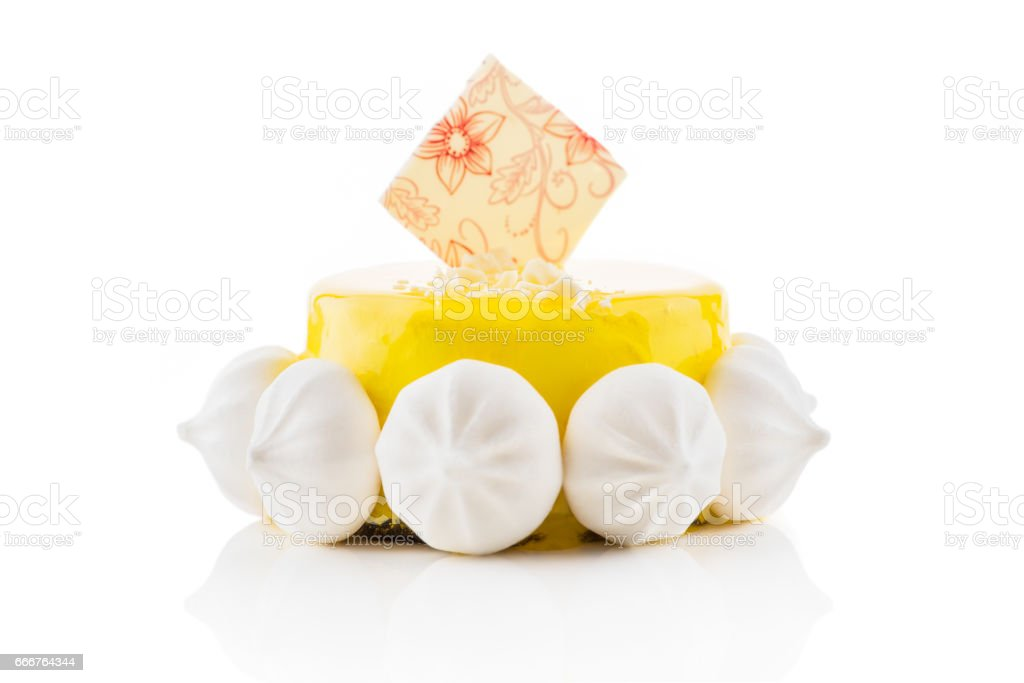Tasty cake with yellow dressing and meringues. foto stock royalty-free