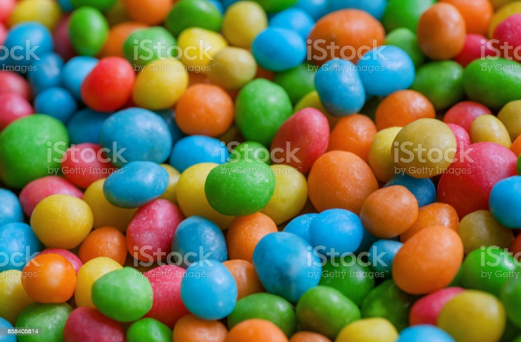Tasty candy decoration background. Heap of colors candies for children with small green, yellow, blue sweets stock photo