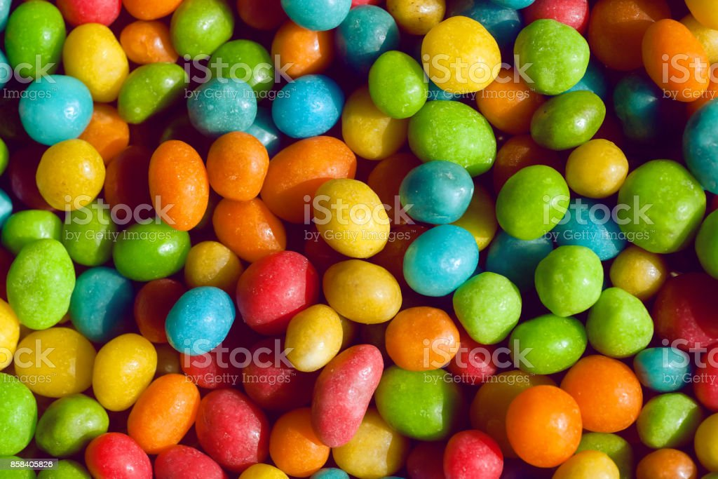 Tasty candy decoration background. Heap of colors candies for kids with small green, yellow, blue sweets stock photo