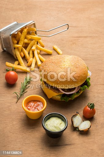 Tasty cheeseburger with french fries