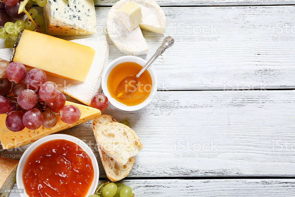 Tasty cheeses on the boards stock photo