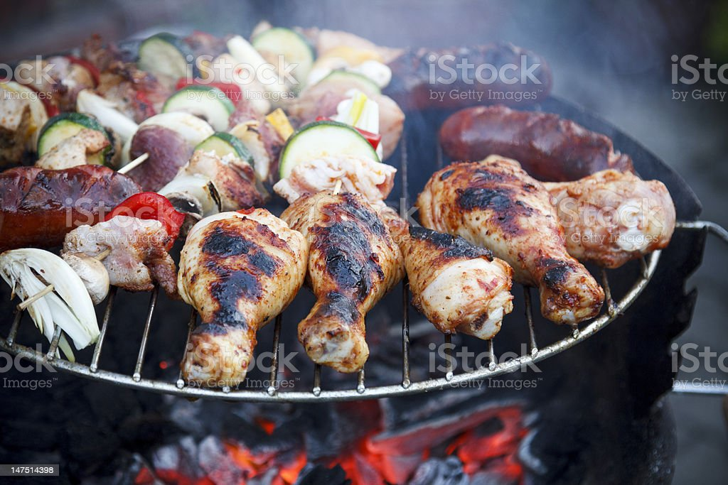 Tasty chicken and pork on a barbecue royalty-free stock photo