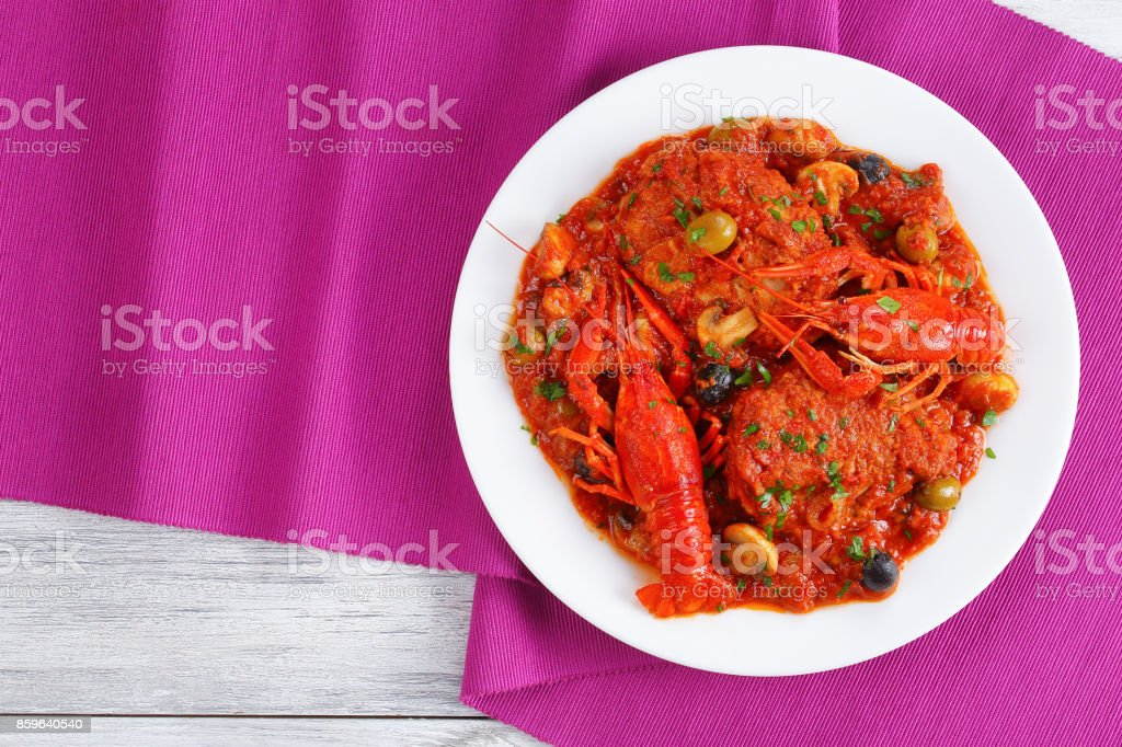 tasty chicken meat stew with crawfishies stock photo