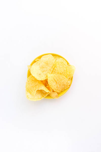 tasty chips isolated on white. Crunchy potato chips on a white background. Food concept. Top view. stock photo