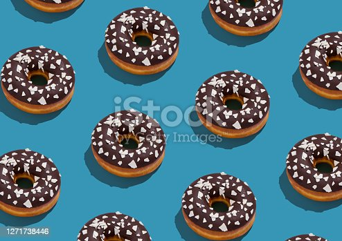 Tasty Chocolate Glazed Donuts Topped With Coconut Flakes Flat Lay On Blue Background, Creative Repeat Design, Geometric Pattern, Top View