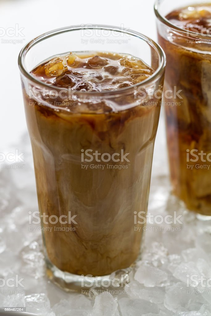 Tasty cold refreshing drink with coffee, milk and ice in glass on ice background. Closeup. foto de stock royalty-free