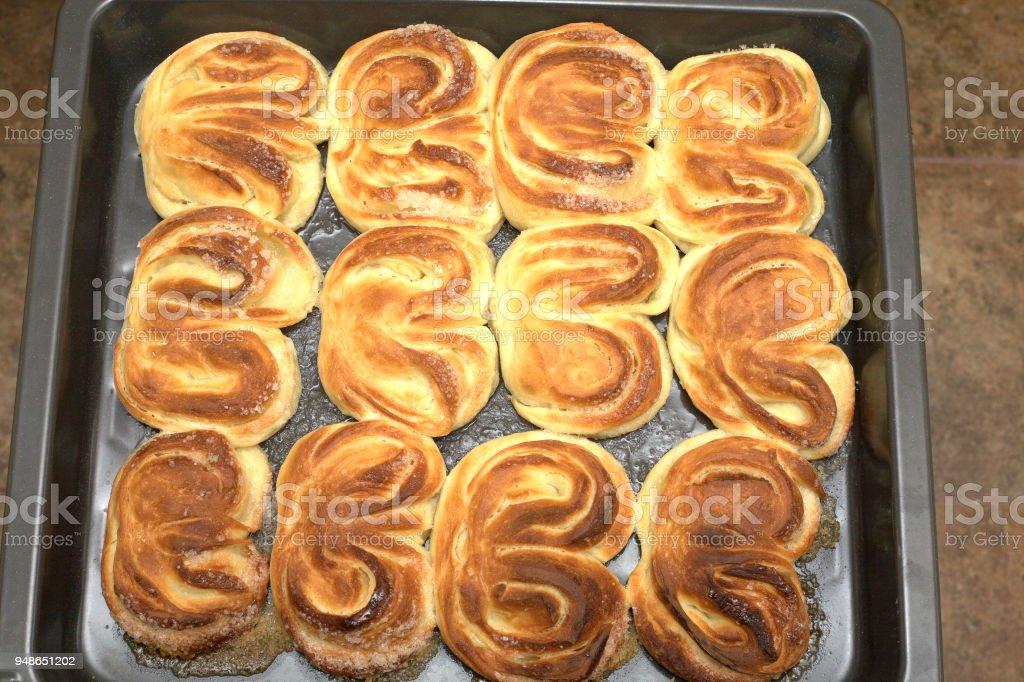 Tasty cooked baking on kitchen tray closeup stock photo