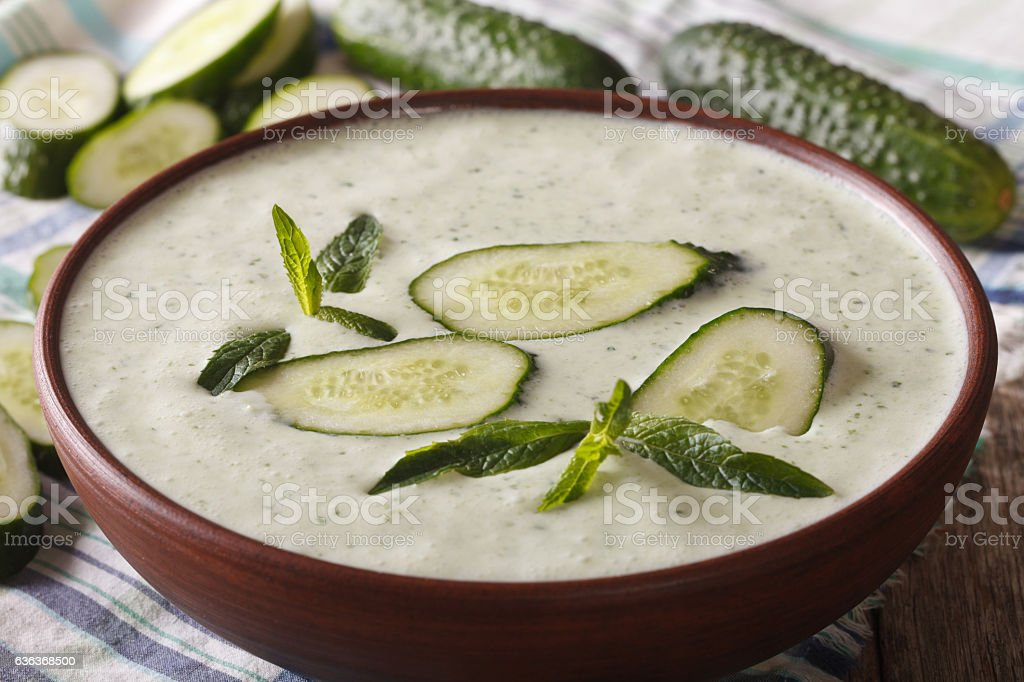 tasty cucumber cream soup with mint macro in a bowl stock photo