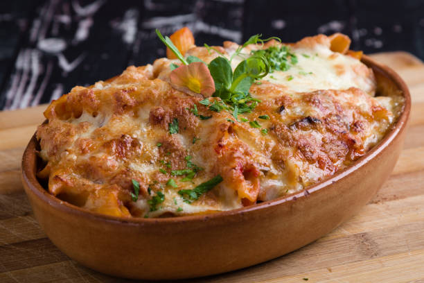 tasty delicious penne rigate pasta in rustic bowl stock photo