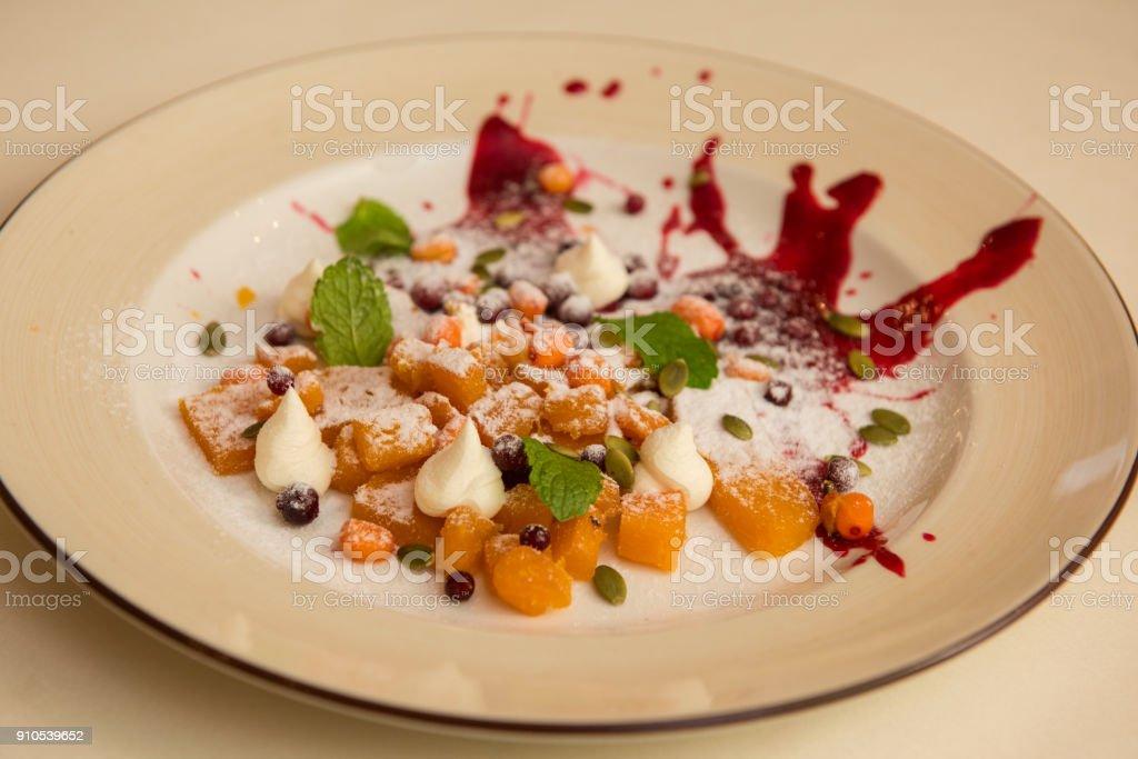 Tasty dessert from pumpkin and sea-buckthorn stock photo