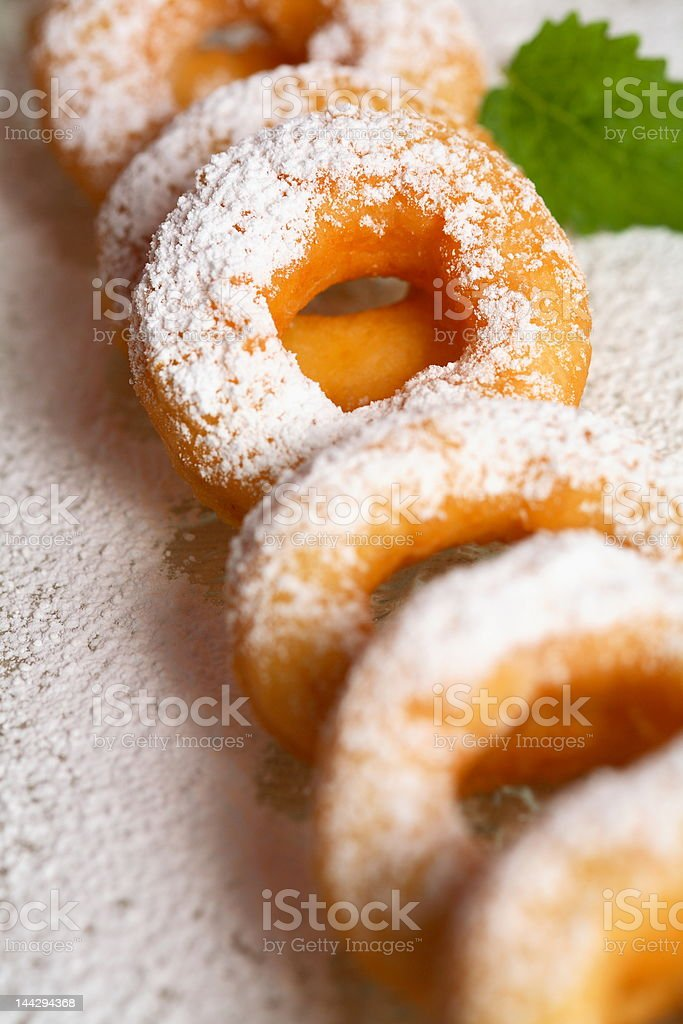 Tasty doughnut with icing sugar stock photo