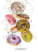 istock Tasty doughnuts in motion falling on white background 847160194