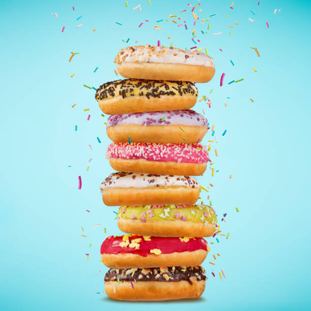 Tasty doughnuts on pastel blue background stock photo