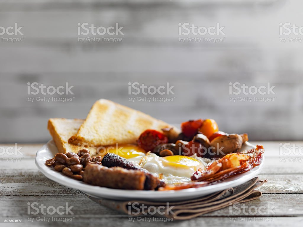 tasty english breakfast on rustic background stock photo