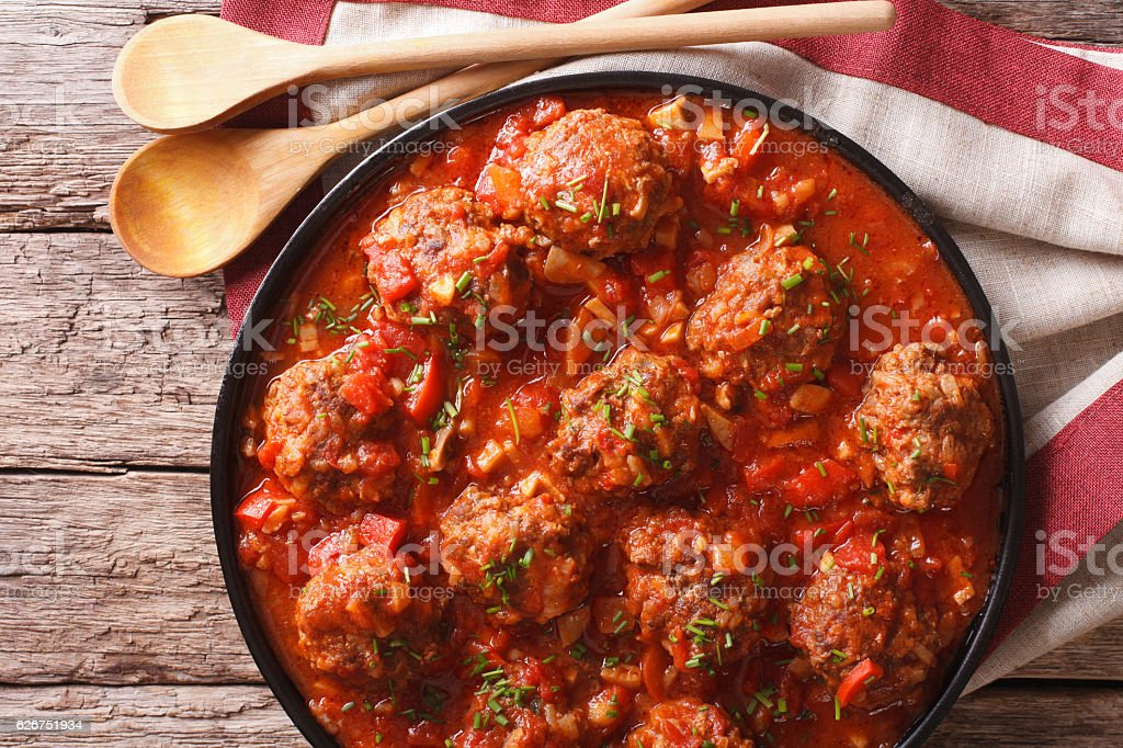 Tasty food: Meatballs albondigas with tomato sauce close-up stock photo