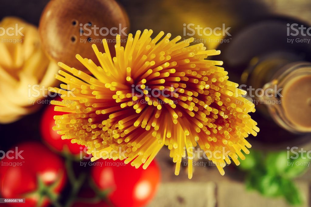 Tasty Fresh Colorful Italian Food Raw Spaghetti on Kitchen Table on Kitchen Background. Cooking or Healthy Food Concept. stock photo