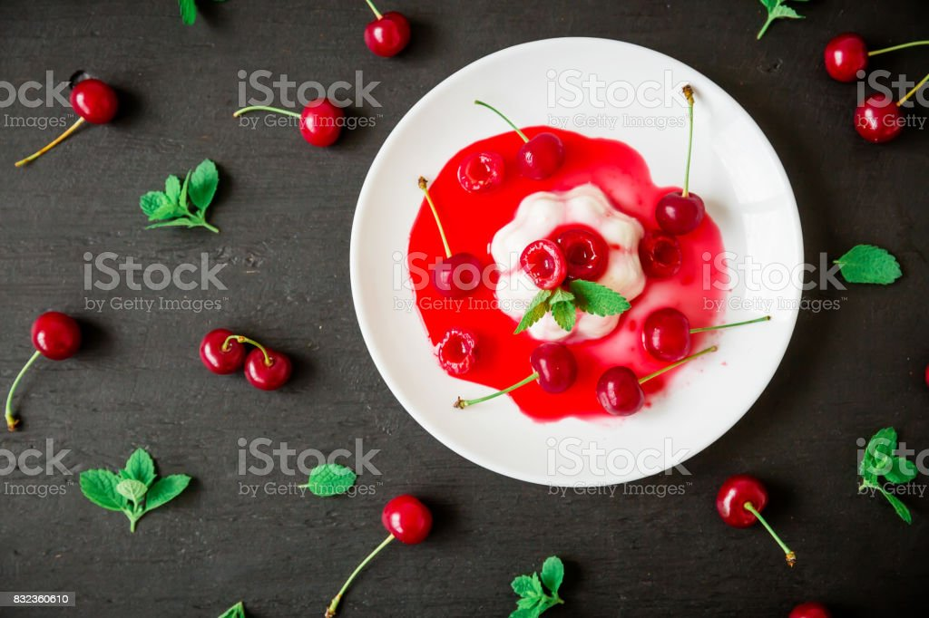 Tasty fruit jelly with cherry berries, traditional Italian dessert on black background. Flat lay. Top view stock photo