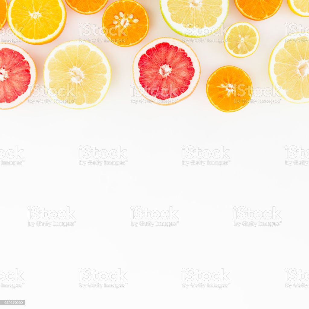 Tasty fruits background. Sliced citrus fruits on white background. Flat lay, top view. foto de stock royalty-free