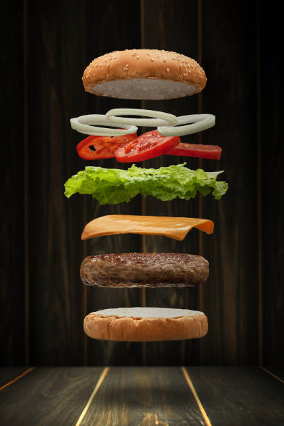tasty grilled beef burger - hamburger stock photos and pictures