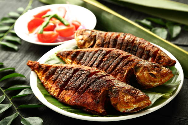 tasty grilled fish. - fish stock pictures, royalty-free photos & images