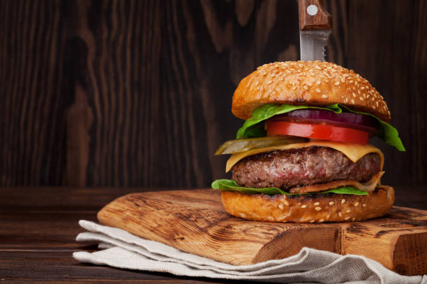 tasty grilled home made burger - kitchen knife stock photos and pictures