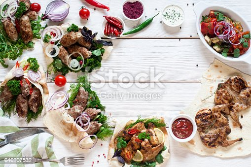 646207652istockphoto Tasty grilled meals frame on wood flat lay 646207532