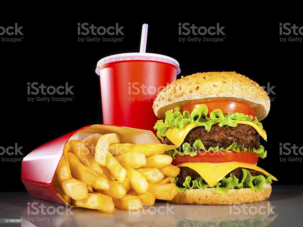 Tasty hamburger and french fries on a dark stock photo